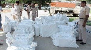 Sirsa: Police with recovered 85 cartons of firecrackers and explosive materials from the Dera premises in Sirsa on Saturday. PTI Photo (PTI9_9_2017_000121B) *** Local Caption ***